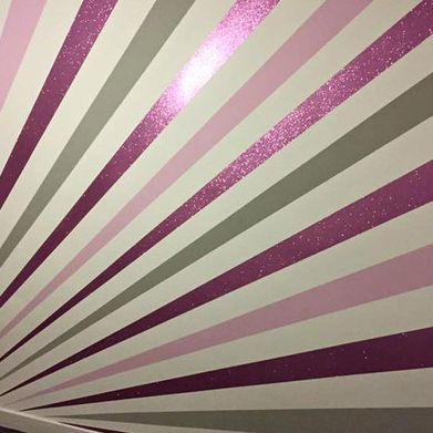 A wall that has been wall papered for our team